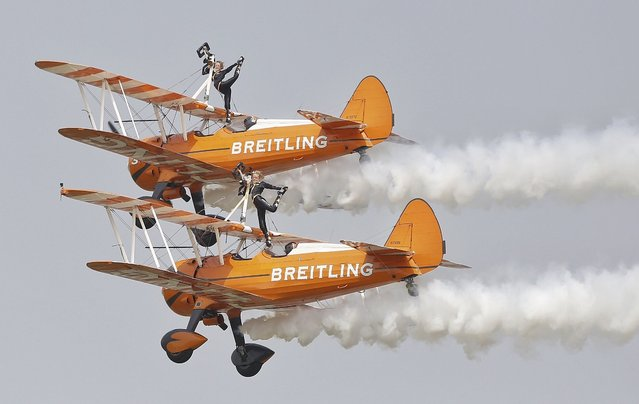Breitling Wingwalkers aircrafts perform during an aerobatic display at an air show in Zhengzhou, Henan province, China, September 25, 201. (Photo by Reuters/Stringer)
