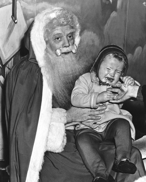 Two and a half year-old Jennifer Martin in tears during a visit to Santa at Harrods department store in London, 10th December 1949. (Photo by William Vanderson/Fox Photos/Hulton Archive/Getty Images)
