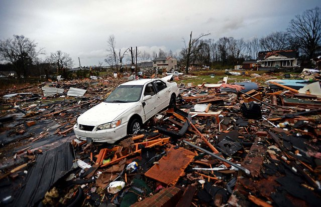 A car sits among the ruins of a building near the Relax Inn on Joe Frank Harris Pkwy in Adairsville. (Photo by Hyosub Shin/Atlanta Journal-Constitution)