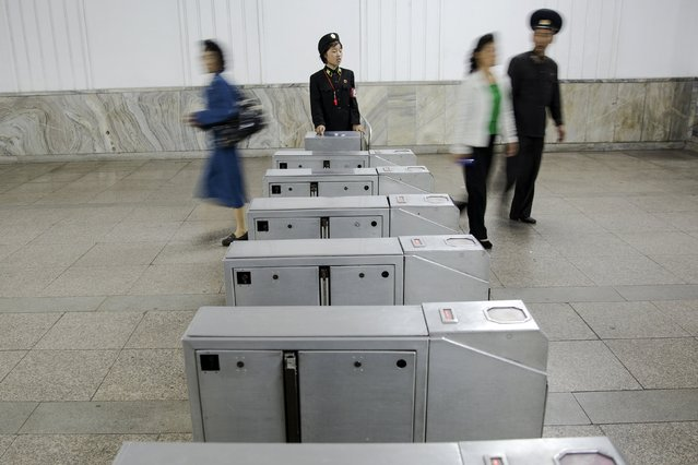 Passengers enter and exit a subway station visited by foreign reporters during a government organised tour in Pyongyang, North Korea, October 9, 2015. (Photo by Damir Sagolj/Reuters)