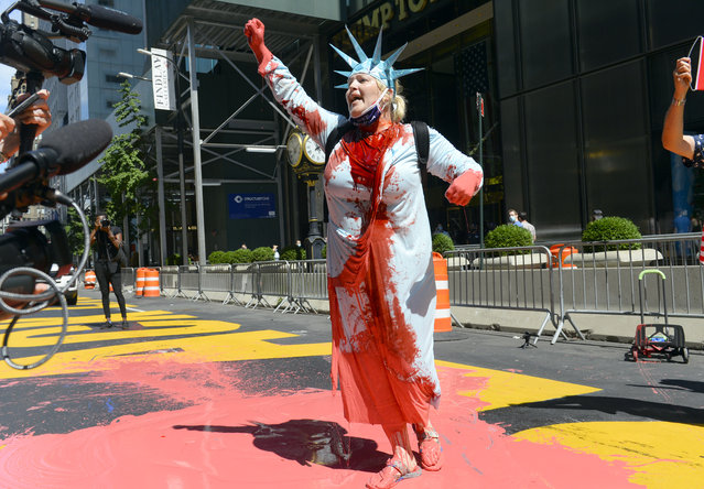 """Activist and Trump supporter Juliet D. Germanotta vandalized the BLM mural in front of Trump Tower on 5th Avenue dressed as """"Lady Liberty"""" in Manhattan, New York on August 23, 2020. (Photo by Rashid Umar Abbasi/The New York Post)"""