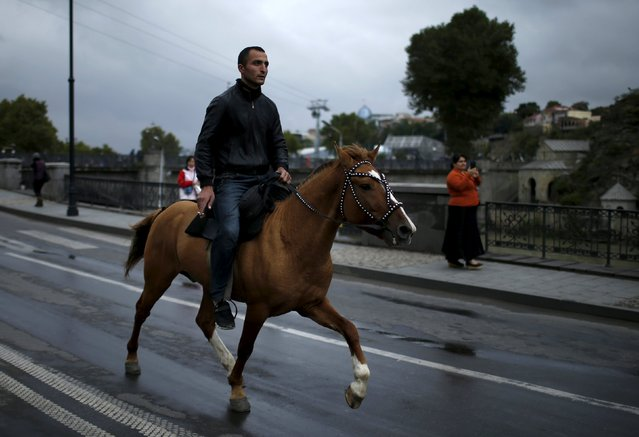 A man rides a horse during the annual Tbilisoba festival, celebrating Tbilisi City Day in Tbilisi, Georgia, October 17, 2015. (Photo by David Mdzinarishvili/Reuters)
