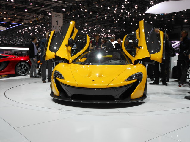 McLaren P1. P1 will cost $1.15 million. Production limited to 375 units. 727 horsepower from gas engine, 176 hp from electric. The production version of McLaren's P1 supercar has been revealed at the 2013 Geneva Auto Show. Finished in bright yellow, the road-ready P1 features a hybrid V8, gull wing doors and a host of high-performance features. (Photo by Luis Fernando Ramos/G1)