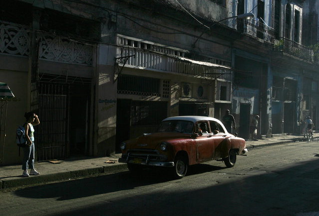 A vintage Chevrolet is driven down a street in Old Havana, September 13, 2006. (Photo by Jorge Silva/Reuters)