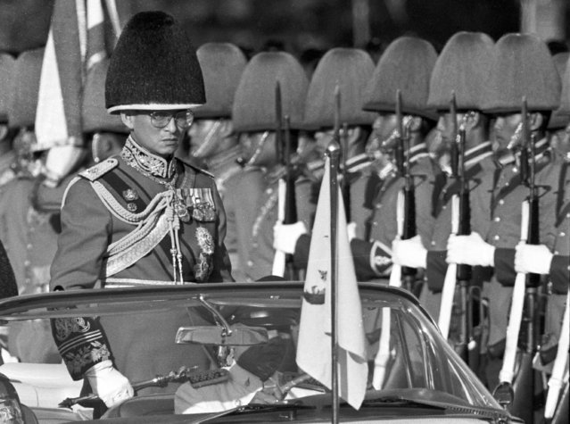 Thai King Bhumibol Adulyadej, the world's longest-reigning monarch, reviews royal guards at an annual trooping of the colours at the Royal Plaza in Bangkok,Thailand in this December 3, 1987 file photo. (Photo by Arthur Tsang/Reuters)
