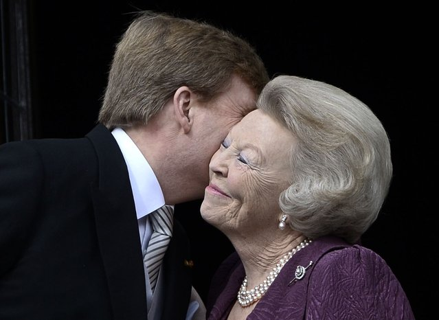 Princess Beatrix of Netherlands (R) embraces his son Dutch King Willem-Alexander at the balcony of the Royal Palace in Amsterdam April 30, 2013. The Netherlands is celebrating Queen's Day on Tuesday, which will also mark the abdication of Queen Beatrix and the investiture of her eldest son Willem-Alexander. (Photo by Dylan Martinez/Reuters)