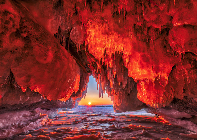 These stunning photographs really do show a land of fire and ice! The frozen landscape of the Olkhon Islands, Russia, appears to be ablaze in some of these pictures as the icy sheets of the glaciers reflect the early morning suns rays. Despite the sub-zero temperatures on the islands, the island is frequently bathed in a low sunlight during the winter months – leading to the formation of these incredible caves, full of icy stalactites. Photographer Vladimir Ryabkov, from Moscow, snapped these incredible images during a visit in March. (Photo by Vladimir Ryabkov/Caters News Agency)