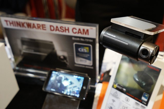 The F750 Thinkware dashboard mounted camera is pictured on display at the International Consumer Electronics show (CES) in Las Vegas, Nevada January 4, 2015. According to Thinkware, the dashboard camera monitors and records driving incidents with built-in FCWS (Frontal Collision Warning System) capabilities. (Photo by Rick Wilking/Reuters)