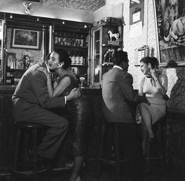1956:  Clients getting acquainted with two prostitutes at a bar in Guatemala City, capital of Guatemala.  (Photo by Evans/Three Lions/Getty Images)