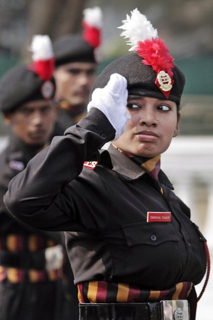 A woman cadet of National Cadet Corps (NCC) walks past the saluting base during the full dress rehearsal for Republic Day rehearsals in Kolkata, India, Saturday, Jan. 24, 2015. U.S. President Barack Obama arrives in New Delhi on Sunday for a three-day visit to talk with Prime Minister Narendra Modi and to be the chief guest in India's Republic Day parade. (AP Photo/Bikas Das)