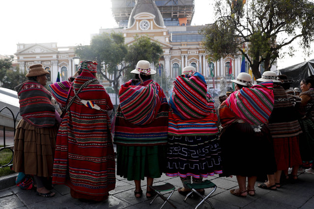 Indigenous people carry out a ancestral ceremony outside Congress in La Paz, Bolivia, Sunday, November 8, 2020, where President-elect Luis Arce will be sworn-in as new president. (Photo by Juan Karita/AP Photo)