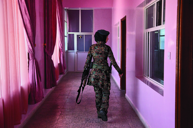 A lieutenant in the elite female counterterrorism unit patrols the women's barracks, Sana'a, Yemen, November 13, 2012. (Photo by Stephanie Sinclair/VII Network/National Geographic)
