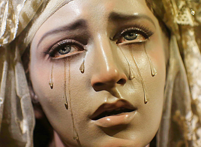 "A wooden carving of ""Virgen de los siete dolores y Madre de todos los que lloran"" (Virgin of the Seven Sorrows and Mother of all those who cry) by Spanish artist Francisco Romero Zafra, is displayed in a church in the Andalusian capital of Seville, southern Spain August 9, 2013. (Photo by Marcelo del Pozo/Reuters)"