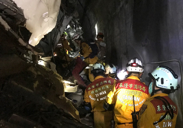 Search and rescue members of the Keelung City Fire Department search people who are stranded and injured in compartments as a train carrying 490 people derails in a tunnel north of Hualien, Taiwan on April 2, 2021. According to Taiwan state media Central News Agency, at least 50 have been killed and dozens injured. (Photo by Keelung City Fire Department/ZUMA Wire/Rex Features/Shutterstock)
