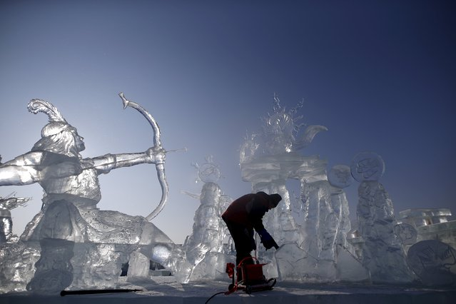 A worker polishes an ice sculpture ahead of the Harbin International Ice and Snow Festival in the northern city of Harbin, Heilongjiang province, January 4, 2016. (Photo by Aly Song/Reuters)