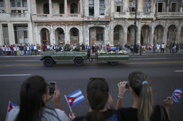 A military vehicle transports the ashes of Cuba's late President Fidel Castro at the start of a three-day journey to the eastern city of Santiago, in Havana, Cuba, November 30, 2016. (Photo by Alexandre Meneghini/Reuters)