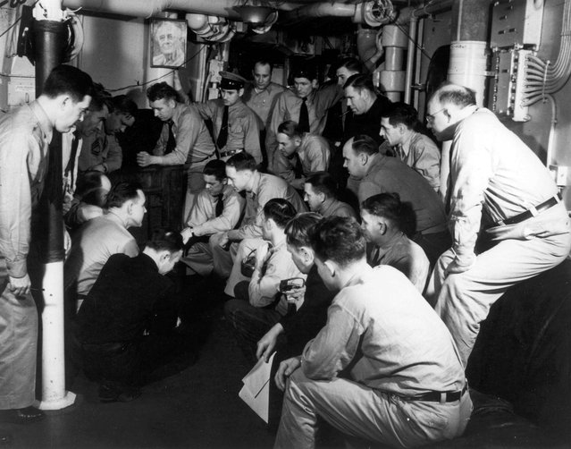 Ship's Chief Petty Officers listen to the radio broadcast of President Franklin D. Roosevelt's address to the Congress requesting a declaration of War against the Axis powers, December 8, 1941. Note the photograph of President Roosevelt on the bulkhead. (Photo by Reuters/U.S. Navy/National Archives)
