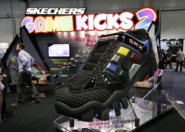 Attendees look at the Skechers booth during CES International, Friday, January 8, 2016, in Las Vegas. (Photo by Gregory Bull/AP Photo)
