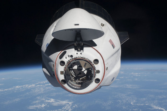 This handout image released on April 27, 2021 courtesy of NASA, shows the SpaceX Crew Dragon Endeavour as it approached the International Space Station less than one day after launching from Kennedy Space Center in Florida on April 24, 2021. The SpaceX Crew-2 astronauts, Commander Shane Kimbrough and pilot Megan McArthur with astronauts Akihiko Hoshide of the Japan Aerospace Exploration Agency and Thomas Pesquet of the European Space Agency, joined the Expedition 65 crew shortly after docking to the Harmony module's forward-facing international docking adapter. (Photo by Handout/NASA/AFP Photo)
