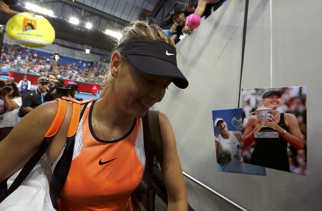 Russia's Maria Sharapova walks off court after signing autographs following her win in her first round match against Japan's Nao Hibino at the Australian Open tennis tournament at Melbourne Park, Australia, January 18, 2016. (Photo by Thomas Peter/Reuters)