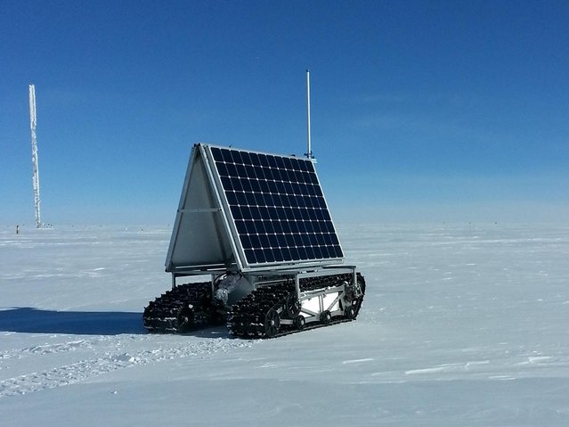 NASA's new Earth-bound rover, GROVER, which stands for both Greenland Rover and Goddard Remotely Operated Vehicle for Exploration and Research, in Summit Camp, the highest spot in Greenland, on May 10, 2013. GROVER is an autonomous, solar-operated robot that carries a ground-penetrating radar to examine the layers of Greenland's ice sheet. Its findings will help scientists understand how the massive ice sheet gains and loses ice. After loading and testing the rover's radar and fixing a minor communications glitch, the team began the robot's tests on the ice on May 8, defying winds of up to 23 mph (37 kph) and temperatures as low as minus 22 F (minus 30 C). (Photo by Lora Koenig/NASA Goddard)