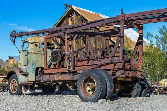 Images of an American ghost town that was home to gold mines and features a plane which crashed during the filming of 3000 Miles to Graceland starring Kevin Costner and Kurt Russell reveal the remnants of the once thriving location. An assortment of rusted vehicles which include a canary yellow bus, caravans and cars have all been left behind in the desert. Other pictures of Nelson, Nevada show its desolate surroundings with only a couple of houses and museums scattered around the area. In one shot, a derelict petrol pump stands still after making its final sale years ago. The stunning photographs were taken by an American photographer known as Abandoned Southeast on a visit to Nelson, Nevada. The area was called Eldorado by the Spaniards who made the original discoveries of gold in the town. The notorious Techatticup gold and silver mine which was associated with crime and murders ran in the area from 1861 to 1942. It was the richest mine in Southern Nevada. (Photo by Abandoned Southeast/Mediadrumworld.com)