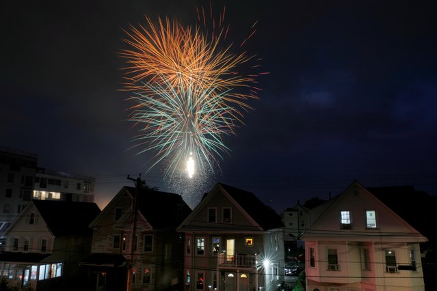 Fireworks explode over homes ahead of the Fourth of July Independence Day holiday in Medford, Massachusetts, U.S., June 30, 2021. (Photo by Brian Snyder/Reuters)