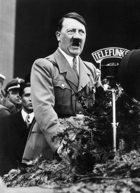 Adolf Hitler,closeup shot of the Chancellor speaking over the radio microphone, 1934. (Photo by Bettmann Archive)