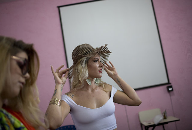 Inmate Veronica Verone, 25, sports a floppy hat as prepares to compete in the 13th annual Miss Talavera Bruce beauty pageant at the penitentiary the pageant is named for, in Rio de Janeiro, Brazil, Tuesday, December 4, 2018. Prison authorities say they organize the annual beauty contest to encourage self-esteem, fight idleness and promote integration among the female inmates. (Photo by Silvia Izquierdo/AP Photo)