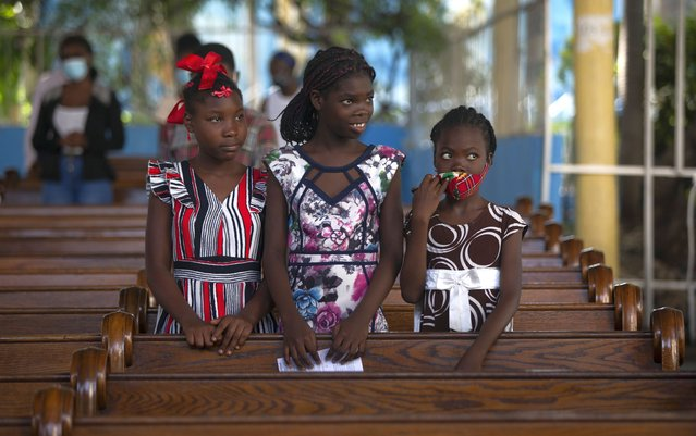 Firls attend Sunday Mass at Sacre-Coeur church, in Port-au-Prince, Sunday, July 11, 2021, four days after President Jovenel Moise was assassinated in his home. (Photo by Joseph Odelyn/AP Photo)