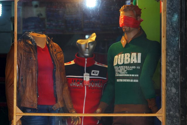 A clothing shop displays its merchandise in the rebel-controlled city of Idlib, Syria November 7, 2015. (Photo by Ammar Abdullah/Reuters)