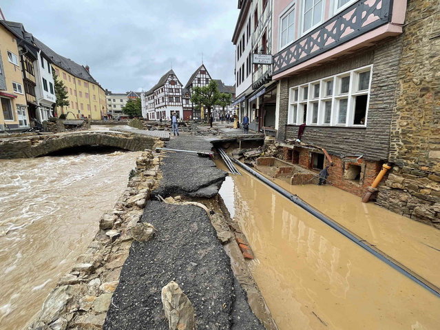 A road is distroyed in Bad Muenstereifel, Germany, Thursday, July 15, 2021 after heavy rainfall and the flooding of the Erft river. People have died and dozens of people are missing in Germany after heavy flooding turned streams and streets into raging torrents, sweeping away cars and causing some buildings to collapse. (Photo by B&S/dpa via AP Photo)