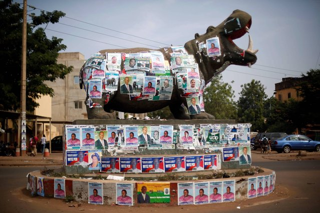 A statue of a hippopotamus is covered with election posters at a traffic circle in Bamako, Mali, Tuesday November 19, 2013. Mali is scheduled to hold parliamentary elections on Sunday, November 24, 2013, in an effort to finalize a return to democracy after a 2012 military coup. Last week residents reported an increase in armed Tuareg rebels in the northern Mali town of Kidal, underscoring the security risks that remain even after a French-led military intervention ousted al-Qaida-linked militants from the major towns in the region. (Photo by Jerome Delay/AP Photo)