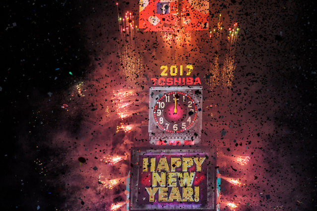 Fireworks and confetti mark the new year in Times Square in New York, U.S. January 1, 2017. (Photo by Stephanie Keith/Reuters)