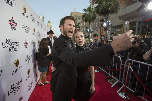 "Cast members Scott Eastwood and Britt Robertson take a selfie at the premiere of ""The Longest Ride"" at the TCL Chinese theatre in Hollywood, California April 6, 2015. (Photo by Mario Anzuoni/Reuters)"