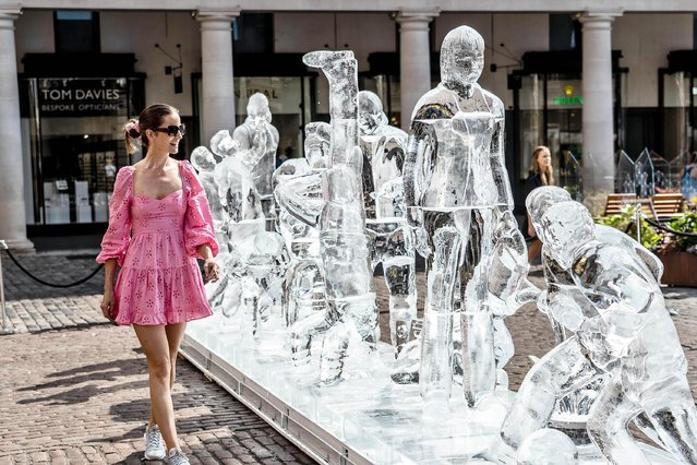 This ice sculpture, created to celebrate the easing of restrictions in England, may not have lasted long in the summer heat beating down in Covent Garden, central London, yesterday July 19, 2021. (Photo by Jeff Moore/Eyevine)