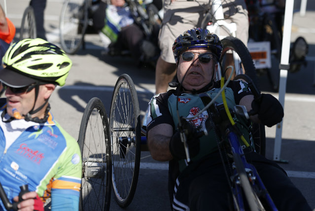 Israeli Defense Minister Moshe Yaalon (R) is riding his hand-cycle as he takes part in a marathon in Tel Aviv, Israel February 26, 2016. (Photo by Amir Cohen/Reuters)
