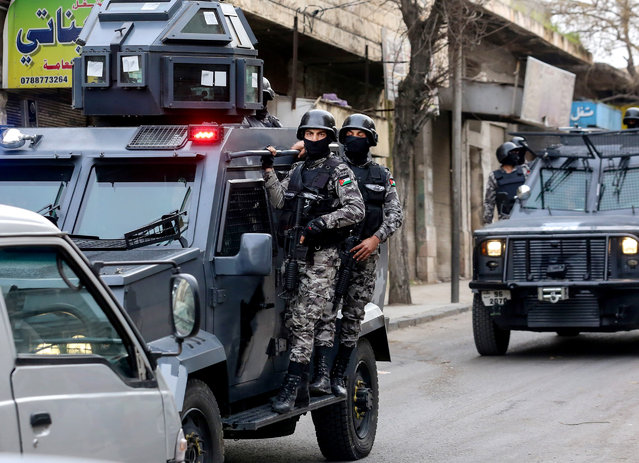 Jordanian security forces secure Hakama street during a raid in downtown Irbid, north of Amman, Jordan, Wednesday, March 2, 2016. Men killed in armed clashes with Jordanian special forces had ties to the Islamic State extremist group and had planned attacks on military and civilian targets in the kingdom, the country's intelligence service said Wednesday. (Photo by Raad Adayleh/AP Photo)