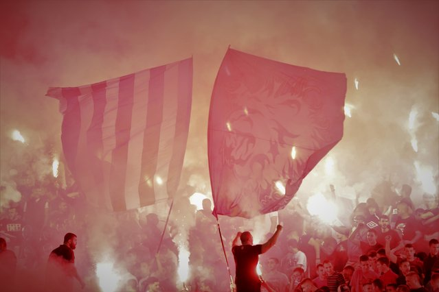 Supporters of Red Star light flares during the Serbian SuperLiga soccer match between Partizan and Red Star in Belgrade, Serbia, 19 September 2021. (Photo by Andrej Cukic/EPA/EFE)