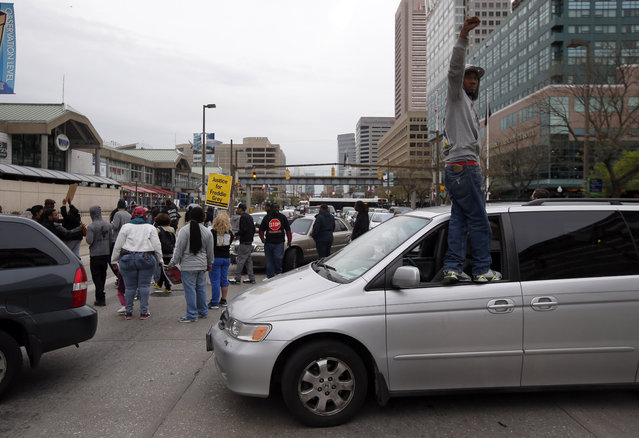 Marchers block the Pratt Street after a march to City Hall for Freddie Gray, Saturday, April 25, 2015 in Baltimore. (Photo by Alex Brandon/AP Photo)