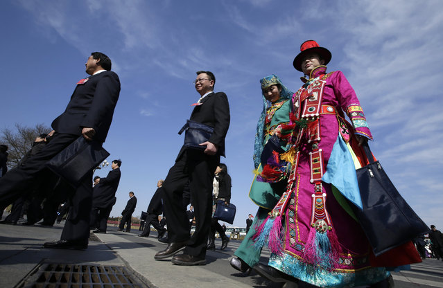 Ethnic Minority delegates arrive for the second plenary session of the National People's Congress (NPC) in Beijing, China, March 9, 2016. (Photo by Jason Lee/Reuters)