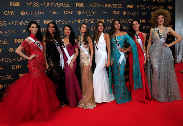 Miss Universe candidates pose for a picture during a red carpet inside a SMX convention in metro Manila, Philippines January 29, 2017. In Photo from L-R: Miss China Li Zhenying, Miss Colombia Andrea Tovar, Miss Finland Shirly Karvinen, Miss Belgium Stephanie Geldhof, Miss Argentina Estefania Bernal, Miss Ecuador Connie Jimenez and Miss Chile Catalina Caceres. (Photo by Romeo Ranoco/Reuters)