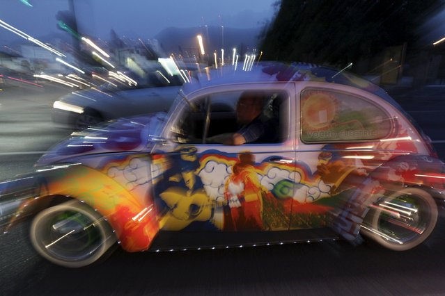 "Rene Penia drives his VW Beetle 1995, locally called ""Vocho"", through the streets of Monterrey April 22, 2015. (Photo by Daniel Becerril/Reuters)"