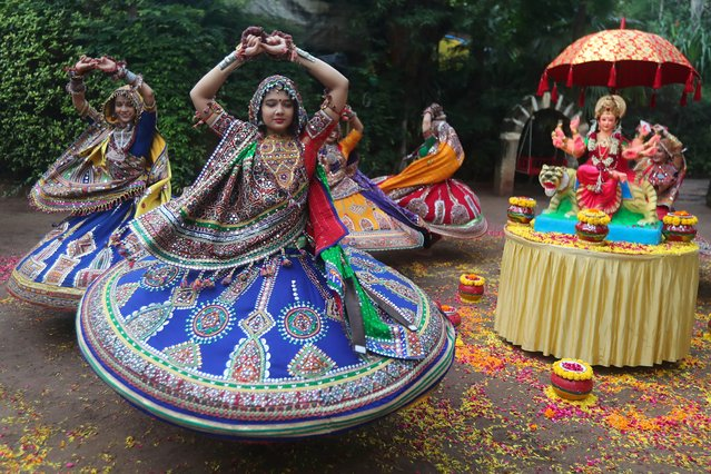 Indian women in traditional attire practice Garba, a traditional dance of Gujarat state, ahead of Hindu festival of Navratri in Ahmadabad, India, Friday, October 1, 2021. The Hindu festival of Navratri or nine nights will begin from Oct. 7. (Photo by Ajit Solanki/AP Photo)