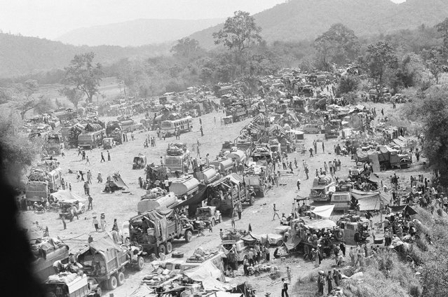 Hundreds of vehicles of all sports fill an empty area as the refugees fleeing in the vehicles pause near Tuy Hoa in the central coastal region of South Vietnam, Saturday, March 23, 1975 following the evacuation of Banmethuout and other population centers in the highlands to the west. (Photo by AP Photo)