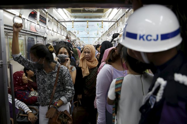 A security personnel stands guard inside a train carriage for women at Manggarai train station in Jakarta, January 8, 2016. (Photo by Reuters/Beawiharta)