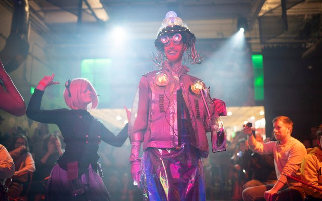 Contestants Connor Bahlo and Aria Trifilio walk the runway through the crowded room of robot fashionistas during the Robot Fashion Show, Sunday, April 28, 2019, in St. Paul, Minn. Tech Dump, the electronics recycling and refurbishing non-profit put on their third annual Robot Fashion Show at Can Can Wonderland in St. Paul. Nine teams created bot-couture costumes and characters inspired by technology. Contestants were judged on creativity, originality, use of repurposed electronics, and audience appeal. (Photo by Jeff Wheeler/Star Tribune via AP Photo)