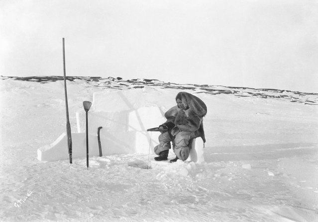 She complains of the challenges of trying to take decent photographs amid waterlogged supplies and harsh weather. Here: Inuit woman ice fishing, Fullerton Harbour, Nunavut, 1905. (Photo by Geraldine Moodie/The Guardian)