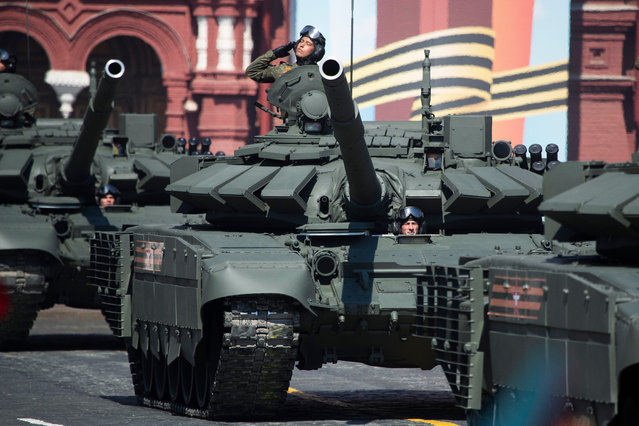 Russian T-72B3 tanks move along Red Square during a rehearsal for the Victory Day military parade in Moscow, Russia, Tuesday, May 7, 2019. The parade will take place at Moscow's Red Square on May 9 to celebrate 74 years of the victory in WWII. (Photo by Pavel Golovkin/AP Photo)