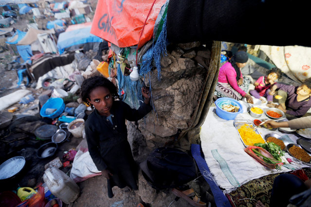 A displaced girl, who fled from fighting in Taiz, is seen during the holy month of Ramadan in a slum on the outskirts of Sanaa, Yemen on May 7, 2019. (Photo by Khaled Abdullah/Reuters)